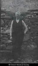 Murdo Nicolson, 26 Laxay standing outside the black house <a href='/image-details/85732'>(more info)</a>